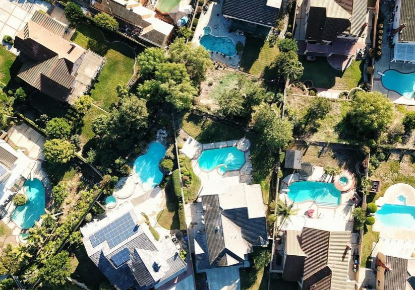aerial view of houses with pools